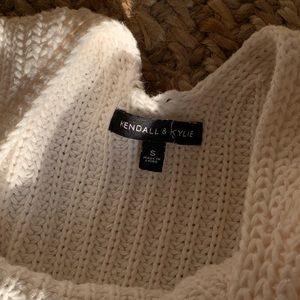 Cream sweater with open back